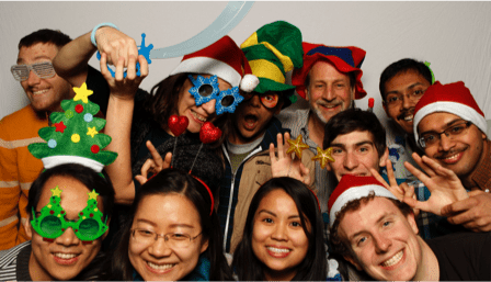 Photo Booth of silly staff with swords and hats