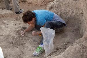 Jill Weber excavating a 1st millennium BC burial.