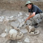 Eli Dollarhide displaying Middle Bronze pottery in situ.